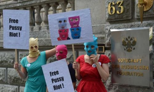 Masked female activists demonstrate in support of members of the feminist punk group Pussy Riot in front of the Russian Embassy in Berlin, Germany, Thursday Aug. 9, 2012. Prosecutors in Russia on Tuesday called for three-year prison sentences for feminist punk rockers who gave an impromptu performance in Moscow's main cathedral to call for an end to Vladimir Putin's rule, in a case that has caused international outrage and split Russian society.