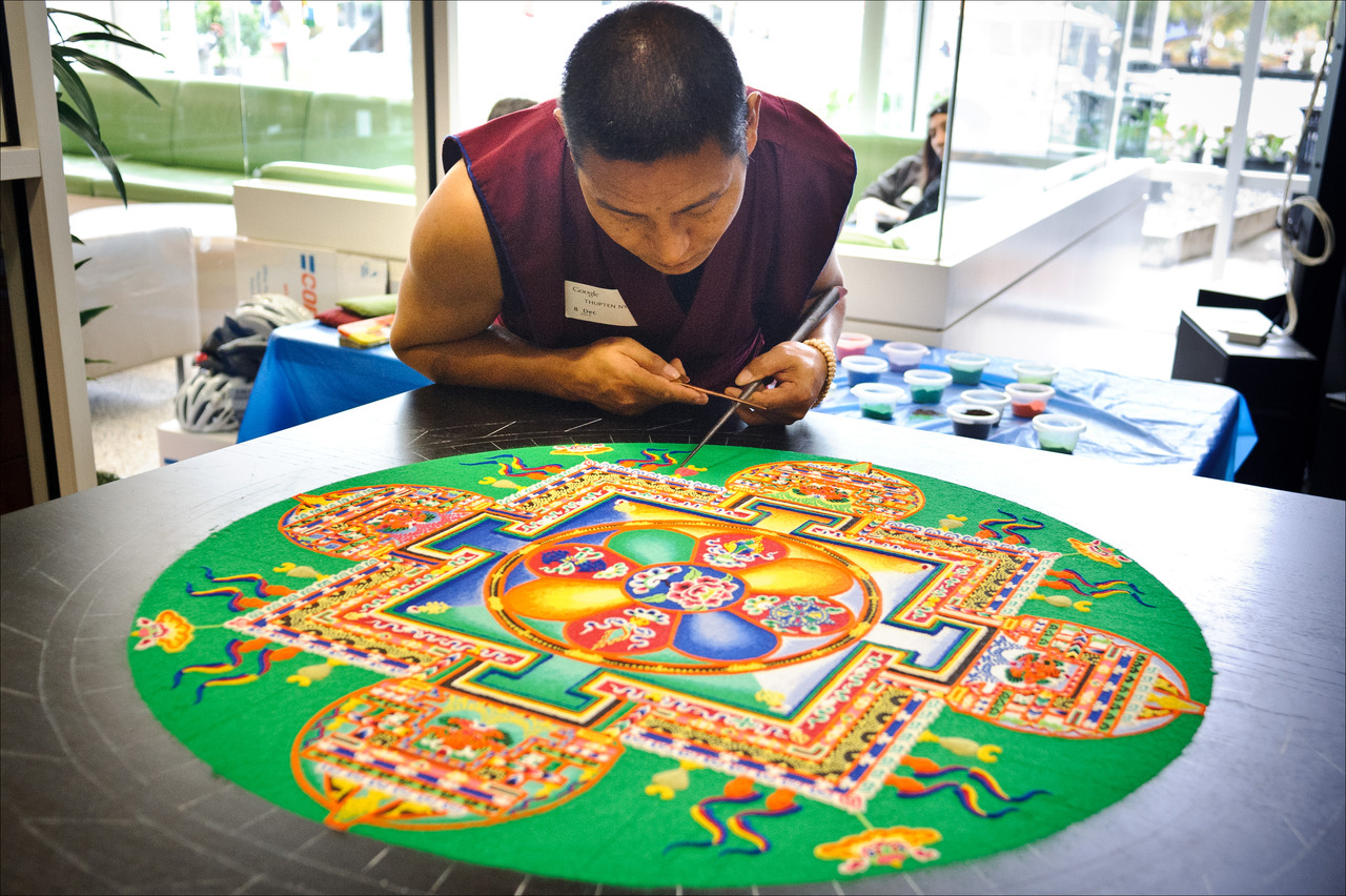 "Six Tibetan Buddhist monks will be visiting from the Drepung Loseling Phukhang Monastery in South India to create a sand mandala in our museum.  Sanskrit for ""circle,"" a mandala is a geometric figure with spiritual and ritual significance, often representing the cosmos. The monks will meticulously apply powdered pigments to an intricate outline, tapping little by little to get the image just right. When completed, the mandala blesses both the environment and its beings. The painstakingly created artwork will then be destroyed and scattered, spreading its peaceful benefits throughout the world. This is a key lesson of Buddhism: everything must come to an end. Nothing is permanent. This is a very special opportunity to see the monks creating a mandala. Don't miss it. Starts tomorrow (Thursday) and lasts through Sunday. You can come tomorrow night after 5pm for just $5. More event details here."