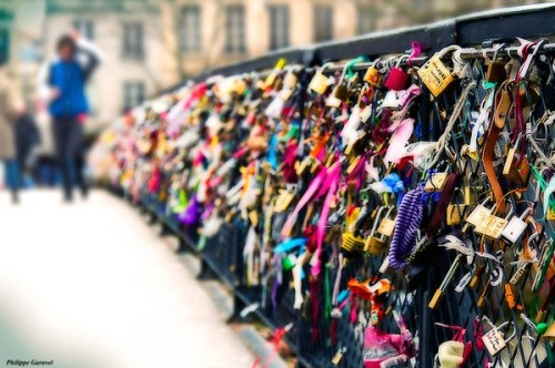 The Lover's Bridge in Paris. Couples attach a padlock to the bridge and throw the key into the river symbolizing their eternal love.  (via)