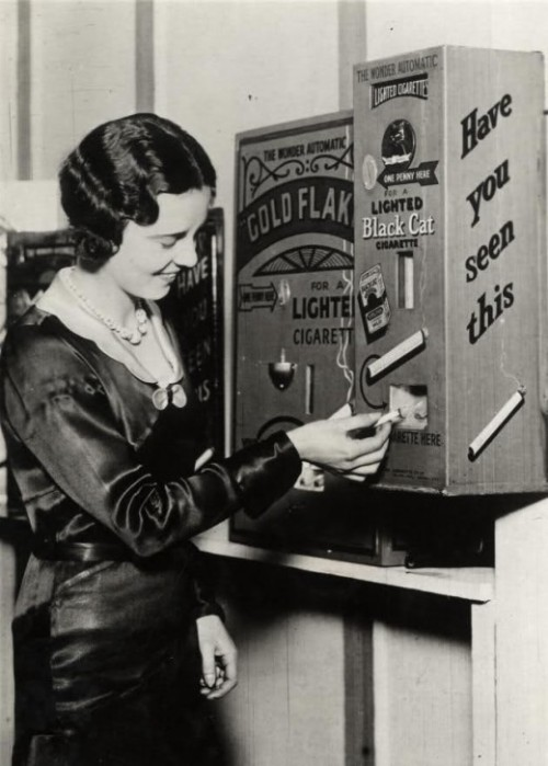 wetcigarettes:  A burning cigarette dispenser (1931)