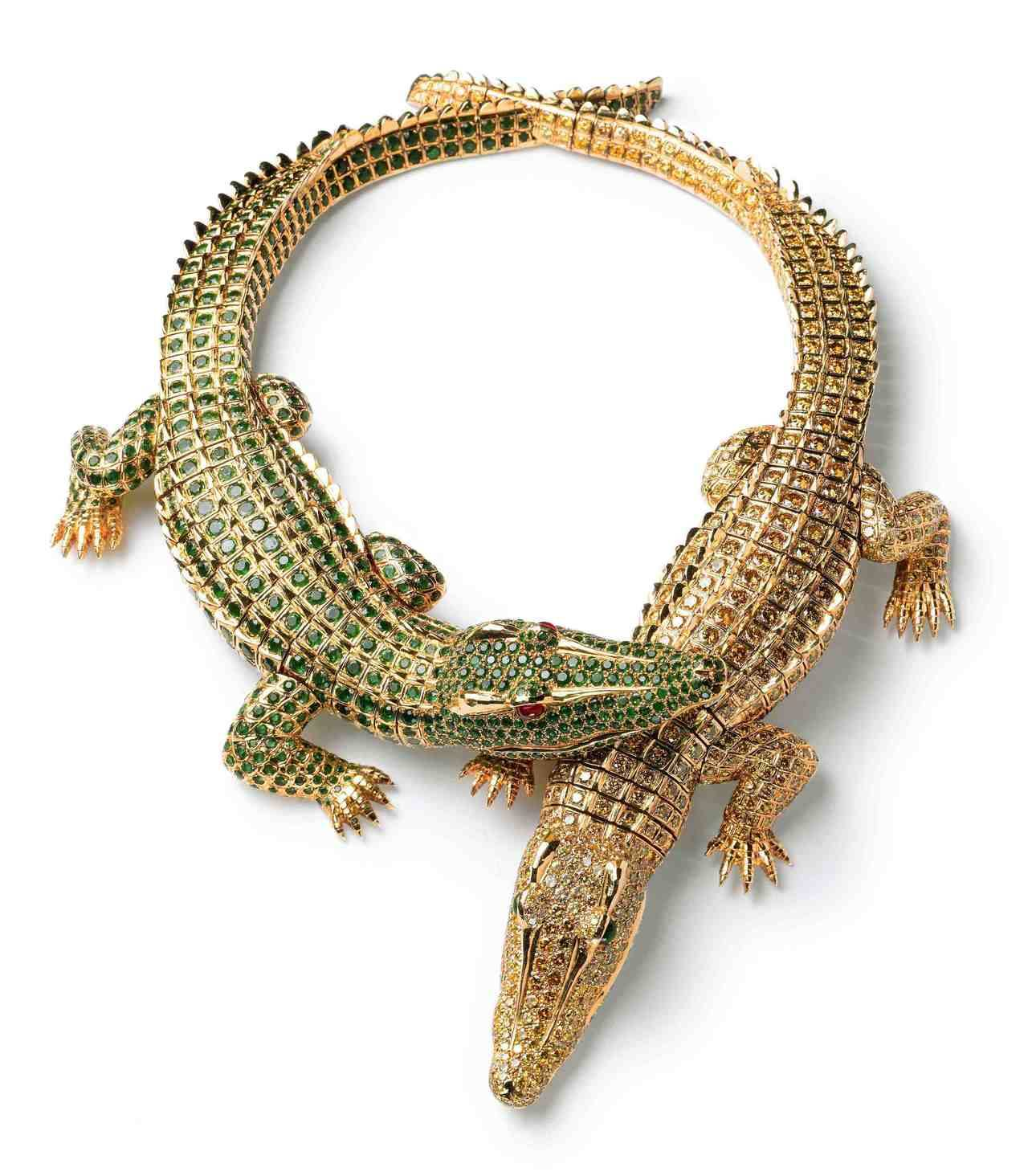 María Félix's famous double crocodile necklace she asked to Cartier to created for her in 1975. The bodies of the crocodiles contain 524.9 grams of gold, and are set with 1,023 yellow diamonds, 1,060 circular-cut emeralds and 2 rubies.