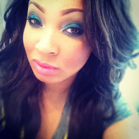 "My makeup today: Blues On the eyes: MAC's ""Electric Eel"", ""Moon's Reflection"", and ""Contrast"" eyeshadows, Milani baked blush in ""Fantastico Mauve"" and MAC's Nicki Minaj Viva Glam lipstick :)"