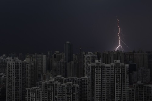 THE SPARK NIGHT   Lightning strikes during a storm over Beijing on Thursday.  (Photo: Aly Song / Reuters via The Wall Street Journal)