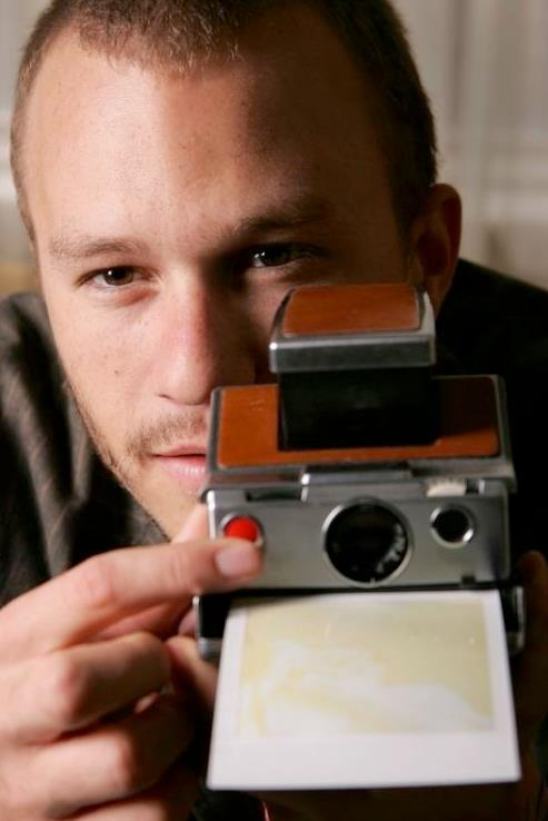 Heath Ledger and a Polaroid land camera