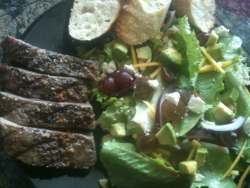 081512: Dinner: Steak N Salad: lettuce mix, red grapes, yellow carrot, red onion, avocado, feta, walnuts, balsamic dijon vinaigrette. Half a petite sourdough baguette with butter and chardonnay smoked sea salt. New york steak, garlic, paprika, butter, salt, cracked peppercorn, parsley.