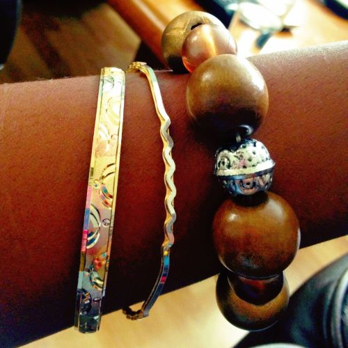 My mixed metal bracelets! I tend to lean towards more golden hued jewelry over silver because I feel like golds are warmer and complement my skin tone better. However, I found the slightly thicker bottom bracelet in my mom's box while looking for a nail clipper and I liked it! So I took it! My mom hasn't even noticed its absence she doesn't like things on her arm. It's hard to tell with the picture, but that bracelet is awesome because it's basically little sections of gold, bronze and silver all mixed together! Finding it inspired me to play around with different metal finishes and textures, hence the wood and silver chunky piece.