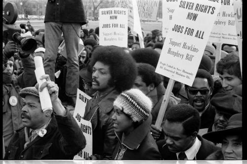Jesse Jackson surrounded by marchers carrying signs advocating support for the Hawkins-Humphrey Bill for full employment January 15, 1975 Thomas J. O'Halloran, photographer U.S. News & World Report Magazine Photograph Collection, Library of Congress