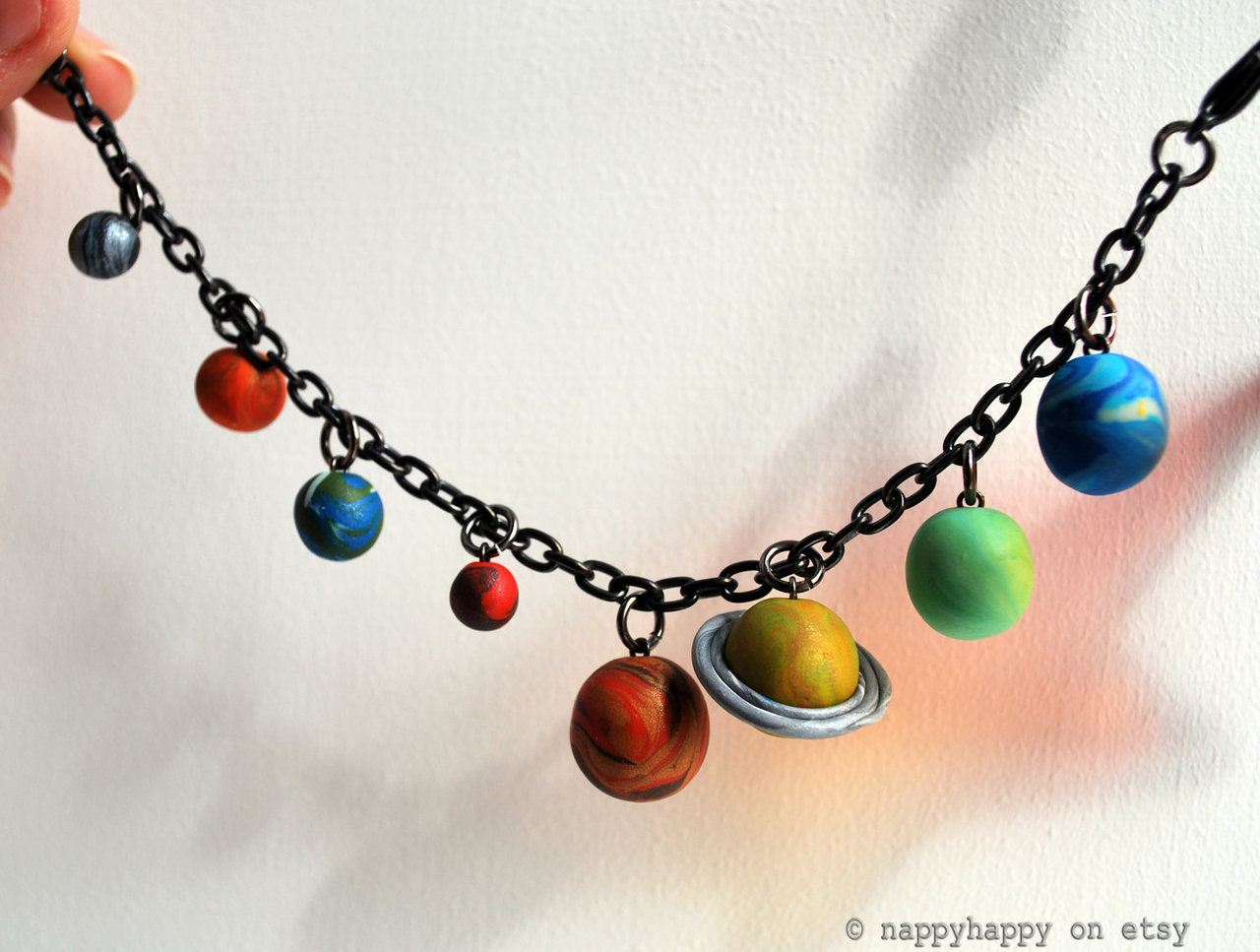 Solar System Bracelet Show your love of our space neighbourhood with this glittering, colourful Solar System Bracelet! Sold on Etsy.