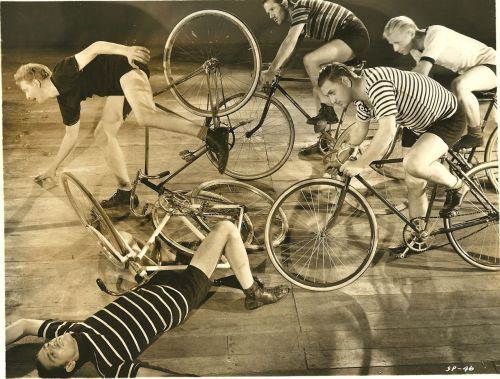 "ridesabike:  ""6 Day Bike Rider"" track cyclists and stunt riders ride bikes, crash bikes. Note: This is a production still from ""6 Day Bike Rider,"" the 1934 Joe E. Brown velodrome-set comedy. If you can identify these riders, please let us know at ridesbike@gmail.com (no ""a""). Many Olympic and competitive cyclists of the day appeared in the film."