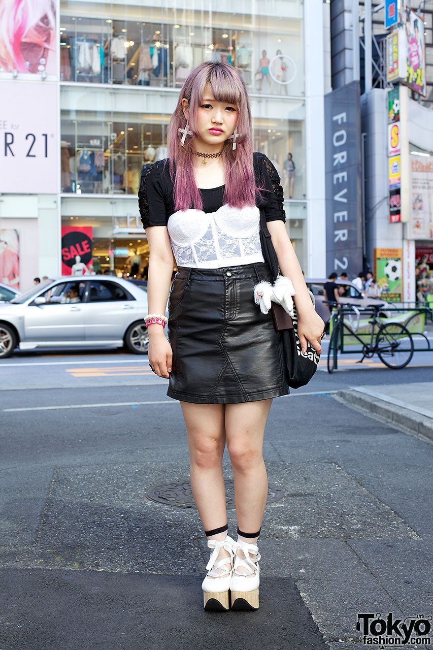 18-year-old Japanese student with pretty hairstyle, bustier top, leather skirt & rocking horse shoes in Harajuku.