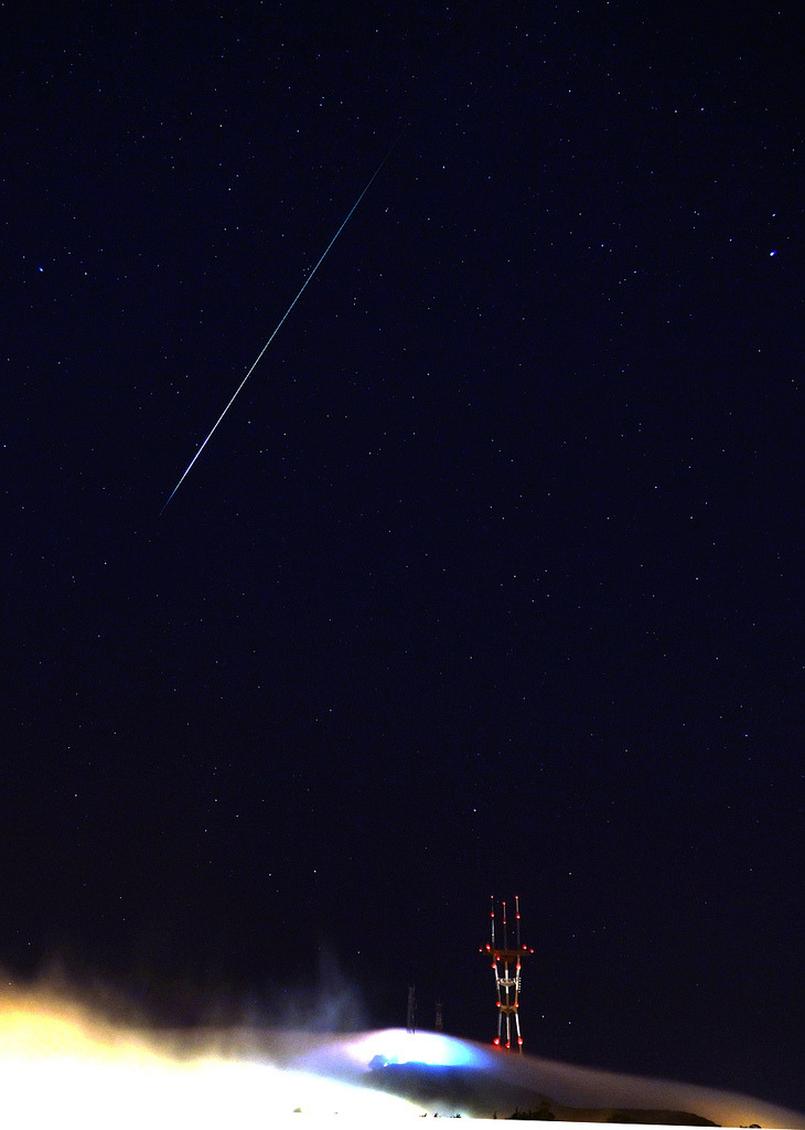 "Can you say ethereal? Trophygeek took this photograph of a lone Perseid meteor over Sutro Tower in San Francisco on Monday night, adding:  ""I happened to be checking on the camera when it happened so I saw it too! Set up the camera to take 8 second exposures all night and caught this large meteor as it streaked over San Francisco. The lights near the tower are cars up on Twin Peaks shining their headlights into the fog.""  ~Trent Gilliss, senior editor"