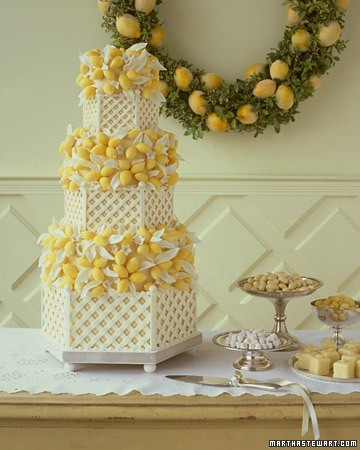 Lemon Wedding Cake  Royal-icing latticework gives this grand cake a summery feel, but the year-round appeal of citrus fruit makes it right for any season. The lemons are actually tinted white chocolate, the blossoms gum paste, and the leaves are white fondant.  (via Wedding Cakes | Martha Stewart Weddings)