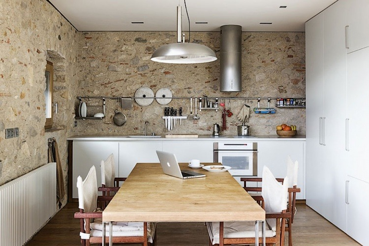 """Barcelona architect Anna Noguera has converted a sixteenth-century ""Alemanys 5"" house in Girona overlooking the Plaça de Sant Domènec into two contemporary holiday apartments."""