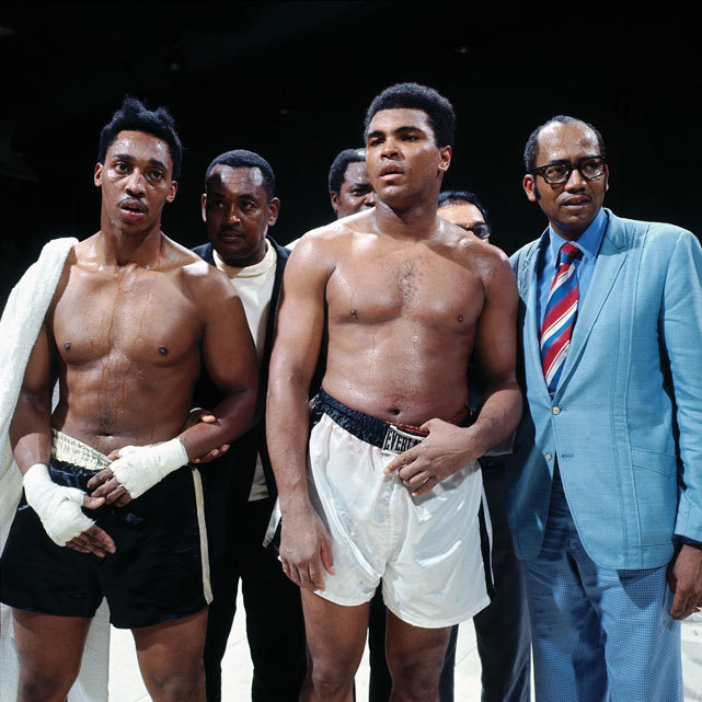Muhammad Ali stands with George Hill after their 1970 exhibition fight on the Morehouse College campus. (Neil Leifer/SI) GALLERY: Muhammad Ali Turns 70 | Top 10 Heavyweights | Newfound Ali Photos