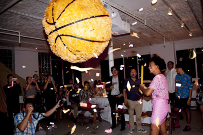 Launch party for the debut issue of OC Annual.  Solange breaking our pinata! See the full story here! http://ow.ly/d08lp Photo by: Matt Kelly