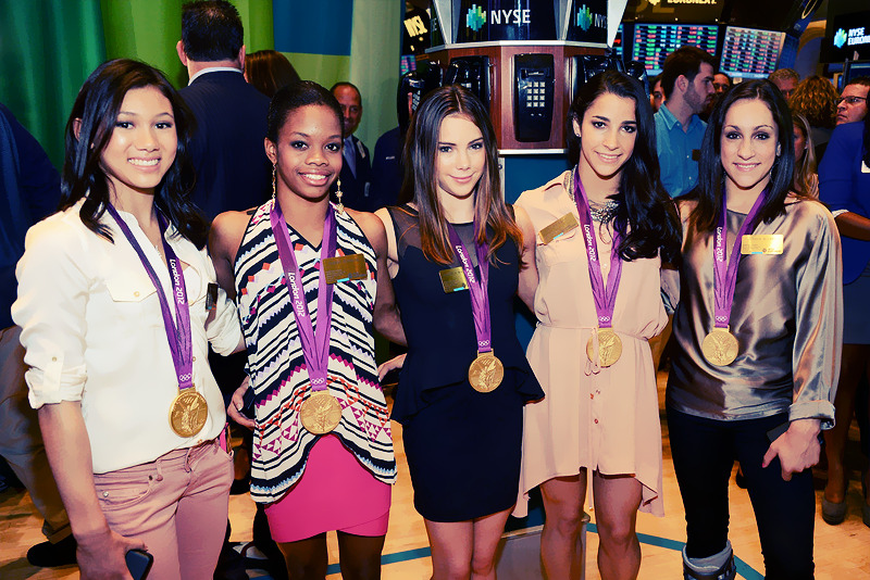 Kyla Ross, Gabby Douglas, McKayla Maroney, Aly Raisman and Jordyn Wieber of the 2012 U.S. Women's Gymnastics Olympic Gold Medal Team ring the closing bell at the New York Stock Exchange on August 14, 2012 in New York City. Photo by Jason Kempin