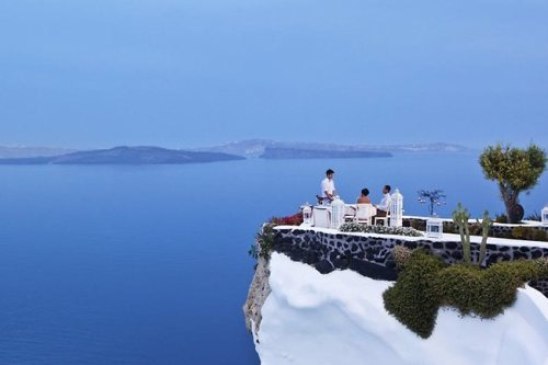 Saturday night I will be dining on this cliff-side Lycabettus in Oia, Santorini.   There's only one table per night. Pinch me.