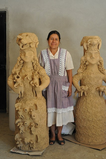 thosevanishedyears:  Ceramic artist Irma Garcia Blanco stands between two of her creations in clay. Santa Maria Atzompa, Oaxaca, Mexico