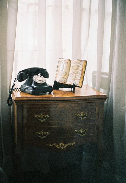 midnighthysteria:  old phone and book by wailintse on Flickr.