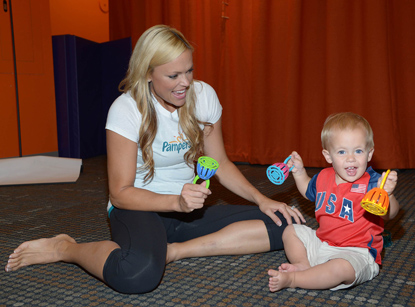 "Former Olympian Jennie Finch plays with her son Diesel who showed his patriotic side by wearing the Pampers Limited Edition ""USA"" diapers in support of the summer Olympics."