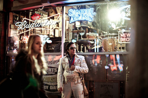 Being Elvis Presley (Photo essay by: Connie Tsang) It's been 35 years since the death of Elvis Presley, but Nashville's Elvis, Chuck Baril, keeps his spirit alive, bringing his jewelled jumpsuit, shades, and high kicks down to Broadway, the city's famed honky tonk strip.