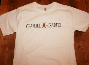 gabrielgadfly:  Just a reminder: I have Gabriel Gadfly t-shirts for sale! I have a full range of sizes available, and I can ship anywhere in the US. Only $14.99! Order yours now, so I can afford to feed my cat.  Hey there feline followers! This guys ^ is an awesome poet. I actually own one of his books and a t-shirt myself!!! Go support him so he can support his feline friend!!! Meow!