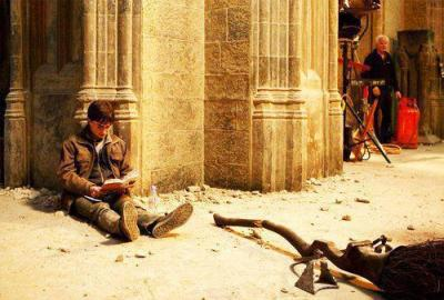Harry Potter reading Harry Potter on the set of Harry Potter during shooting of Harry Potter.