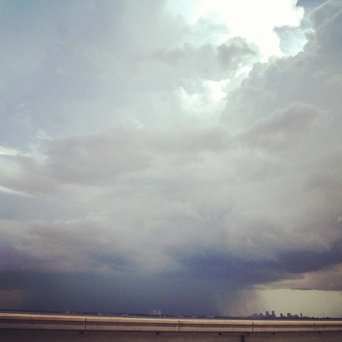 A downpour over the city skyline. #neworleans #nola #lake #sky #clouds #rain #storm #nature  (Taken with Instagram)