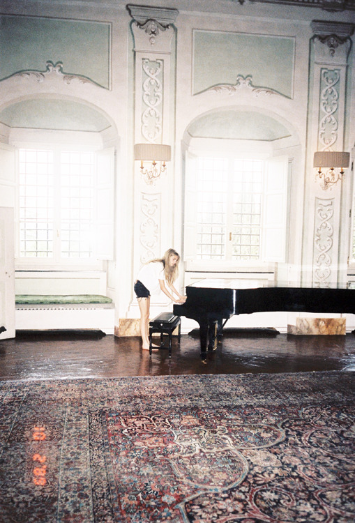 vogueweekend:  Cara Delevingne playing piano at Ferragamo's countryside house near Florence, July 2012