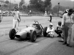 1960 Lime Rock Nationals– Denise McCluggage sits on the grid  while SCCA gets things straight. Back in 1955 or so, a young Denise McCluggage had a chance encounter with a then unknown Steve McQueen which led to a brief affair and a long-lasting friendship. They would be separated by their own career ambitions, and the many demands and erratic schedules that come with the territory. That said, McCluggage managed to stay in touch over the years. She herself would go on to become a legend in the world of auto racing– a renowned driver, writer, and photographer for over 50 yrs. McCluggage has won trophies around the world and raced for Porsche, Jaguar, Lotus, Mini Cooper, Alfa, Elva, OSCA, Volvo, among others. In 1961 she won the grand touring category at Sebring in a Ferrari 250 GT, and in 1964 McCluggage scored a class win in the Rallye de Monte Carlo for Ford. She recalls a young, lean McQueen who was already obsessed with cars and racing, who swept her off her feet with his searing looks, charm and well… incongruity, as she puts it.