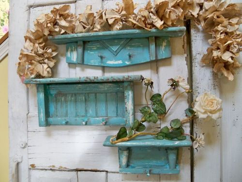 Awesome shelf trio. I made these out of wooden abandoned finds.