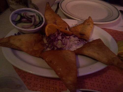 A Vegetarian Curry Puff at a Thai restaurant called Ploy II in the Haight Ashbury district.  Although this was not named a samosa on the menu, I am including it here since it did look like one. I ordered it thinking it would be similar to a Indian veg puff - but it turned out to be a deep fried small samosa covered in a sweet syrup, stuffed with veggies. You get 5 of those for $6 so its well worth the price.