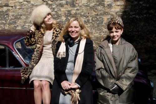 "Director Lone Scherfig with actors Rosamund Pike and Carey Mulligan on the set of the 2009 film ""An Education"". Click the pic to watch an interview with Mulligan and co-star Peter Sarsgaard discussing the production."