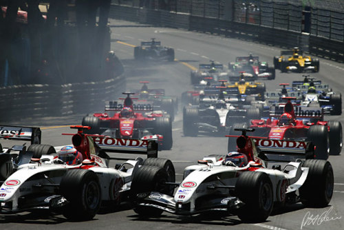 Taku and Jense jostle with Raikkonen through the first turn in 2004.
