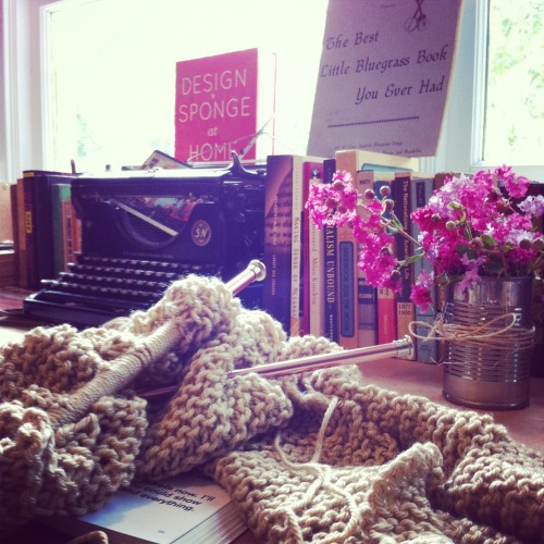 teacoffeebooks:  Almost done with my second knitting project. Got a new table for my library and I'm totally in love.