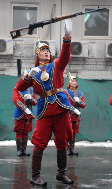 Ceremonial… A Mongolian soldier in traditional garb performs with his SVD Dragunov rifle at a base in Kabul. The irony here is that the infamous Genghis Khan himself brutalized Afghanistan, managed to occupy it but historically is said to have never completely conquered it.