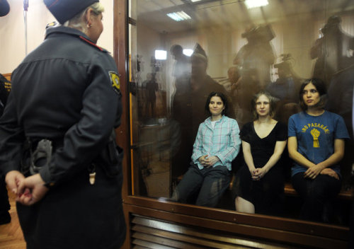 "inothernews:Members of the Russian punk bank Pussy Riot sit inside a detention box during their court appearance in Moscow on Friday.  A judge in the case — appointed to the bench by president Vladimir Putin — found band members Nadezhda Tolokonnikova, Yekaterina Samutsevich and Maria Alyokhina guilty of ""hooliganism""  for a performance at Moscow's main cathedral in February.  They were sentenced to two years in prison.  (Photo: Andrey Smirnov / AFP-Getty via The New York Times)"