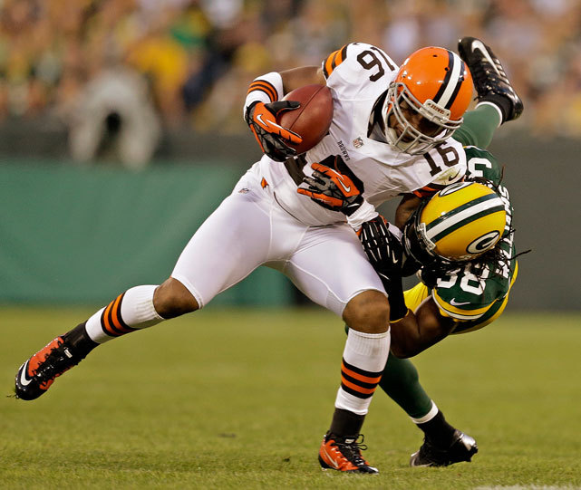 Josh Cribbs is tackled by Tramon Williams after a catch during the first half of Thursday's Browns-Packers game in Green Bay. The Browns rolled to a 35-10 victory in both team's second exhibition game. (AP Photo/Jeffrey Phelps) TRAINING CAMP POSTCARDS: Browns | Packers | IndexBURKE: QB Races among Week 2 preseason storylinesBANKS: Winners, losers from preseason's first week