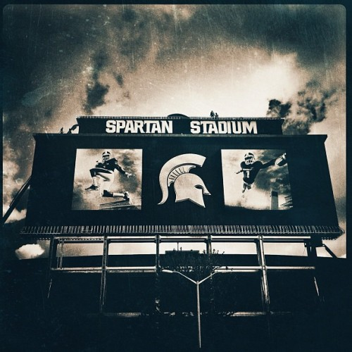 Scoreboard again #iphone #hipstamatic #noir #monovue #sky #clouds #msu #football #spartanstadium  (Taken with Instagram)