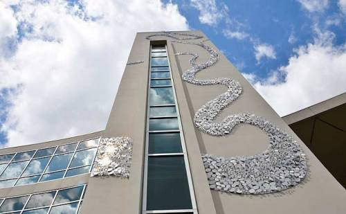 Tampa Wind by artist Stacy Levy is a wind activated rendering of a section of the Hillsborough River as it passes through the eastern edge of the USF Tampa Campus.