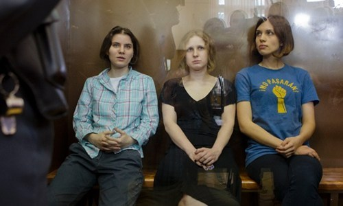 "thedailywhat:  Breaking News of the Day: Pussy Riot Gets 2 Years In Jail: Meanwhile in Russia: Three members of Russian punk band Pussy Riot each have been sentenced to two years in jail for an obscenity-laced performance at Moscow's Christ The Savior cathedral in February in which they were so bold as to criticize Russian President Vladimir Putin. The woman — Nadezhda Tolokonnikova, 23; Maria Alekhina, 24; and Yekaterina Samutsevich, 29 — are made of tough stuff. As the verdict came down, and a shout of ""Shame!"" was heard in the courtroom, they just laughed. Judge Marina Syrova convicted the women of hooliganism motivated by religious hatred, saying they had ""crudely undermined social order.""  Here's MORE 'motivation' of the judge for railroading this anarcho-punk band: ""The court does find a religious hatred motive in the actions of the defendants by way of them being feminists who consider men and women to be equal.""  Now forget the judge being a traitor to her gender, she's an utter idiot because HER EVERY PRESENCE on the Bench is a similarly ""religious hatred motive""by considering a woman can be equal(like holding the office of…I dunno A FUCKING *JUDGE*) to a man.  She cited three specific elements for finding the trio guilty: The choice and timing of venue. Their continued performance and resistance to be taken outside by security and cathedral parishioners. The defendants' conduct and their accomplices afterwards. Here's the shocking performance that started it all. [death+taxes]"