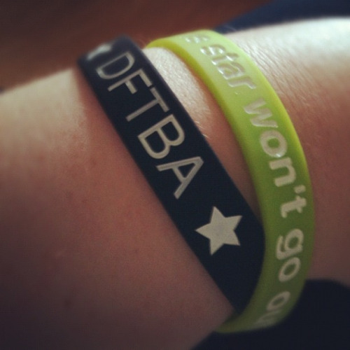 shimmyimmie:  Nerdfighters, hooha! on Flickr. Got my DFTBA and This Star Won't Go Out bracelets today :D