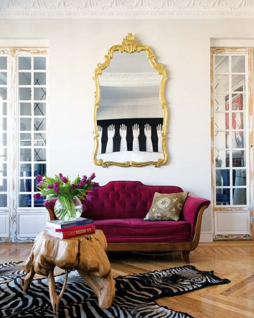 thatgirlgwen:  thedecorista:  such a stylish sofa and gold mirror combo  And the coffee table! I can't get over the coffee table.