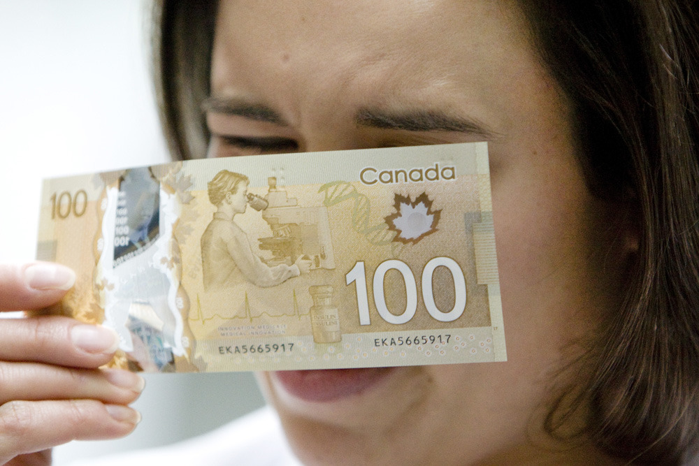 "Bank of Canada bans image of Asian woman from $100 billThe Bank of Canada has purged an image of an Asian-looking woman from its new $100 banknotes after focus groups raised questions about her ethnicity.The original image intended for the reverse of the plastic polymer banknotes, which began circulating last November, showed an Asian-looking woman scientist peering into a microscope. The image, alongside a bottle of insulin, was meant to celebrate Canada's medical innovations.But eight focus groups consulted about the proposed images for the new $5, $10, $20, $50 and $100 banknote series were especially critical of the choice of an Asian for the largest denomination.""Some have concerns that the researcher appears to be Asian,"" says a 2009 report commissioned by the bank from The Strategic Counsel, obtained by The Canadian Press under the Access to Information Act. (Peter J. Thompson/National Post)"