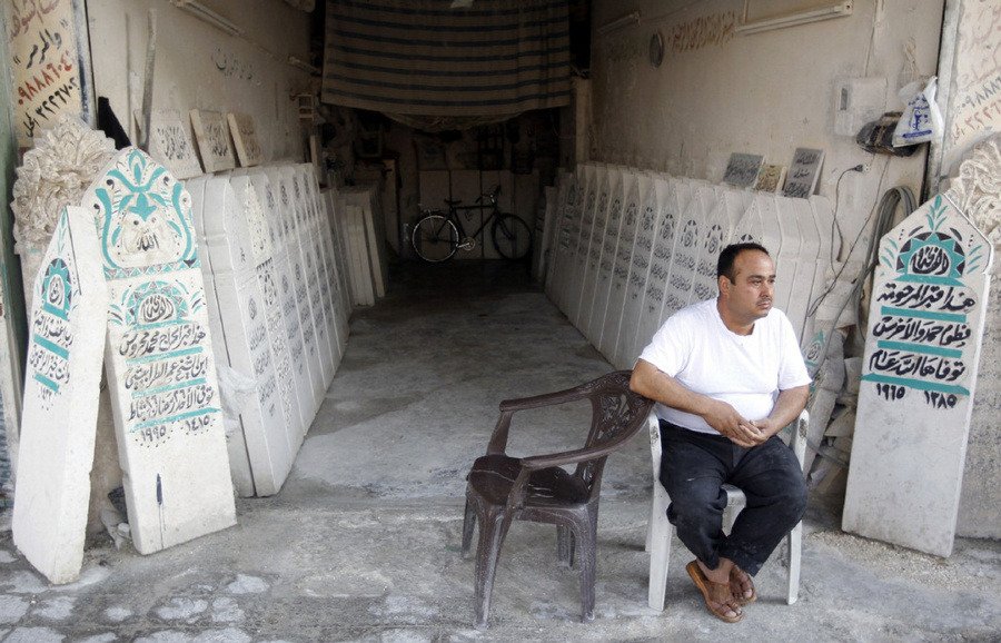 شاهد على الموت في حلب-  #سوريا  A man sits in front of tombstone workshop in #Aleppo on Aug. 15. Activists say more than 20,000 people have been killed since an uprising against President Bashar Assad's regime started in March last year and the conflict has morphed into a full-out civil war.  GORAN TOMASEVIC/REUTERS
