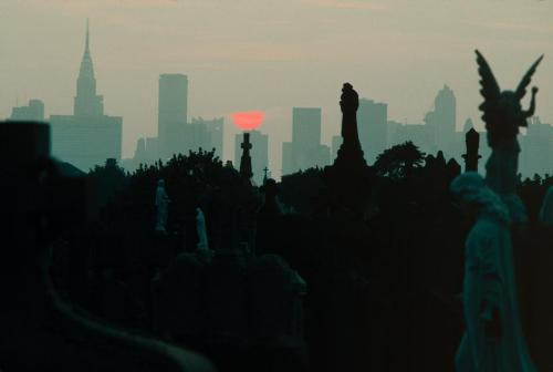 k-a-t-i-e-:  The Midtown Manhattan skyline seen from a Queens cemetery New York City, 1983 Thomas Hoepker