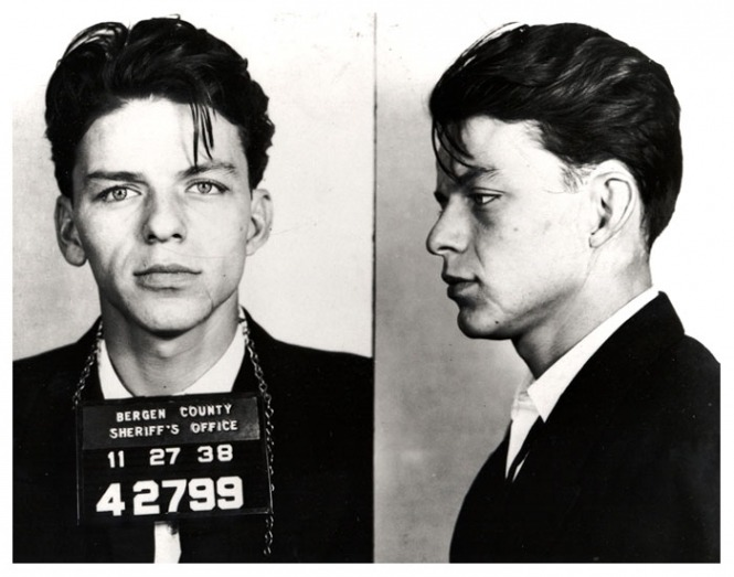 collective-history:  Frank Sinatra's mug shot ca. 1938 Frank Sinatra was arrested by the Bergen County, New Jersey sheriff in 1938 and charged with carrying on with a married woman. The charge was later changed to adultery, and eventually dismissed. I wonder if the married woman got arrested too, for you know, cheating.  via