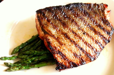 grilled salmon over a bed of garlic asparagus
