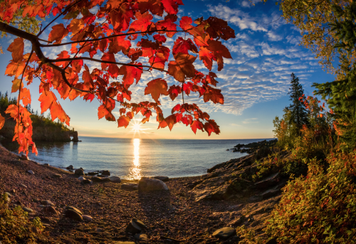 ecocides:  Autumn sunrise on Lake Superior | image by Rikk Flohr