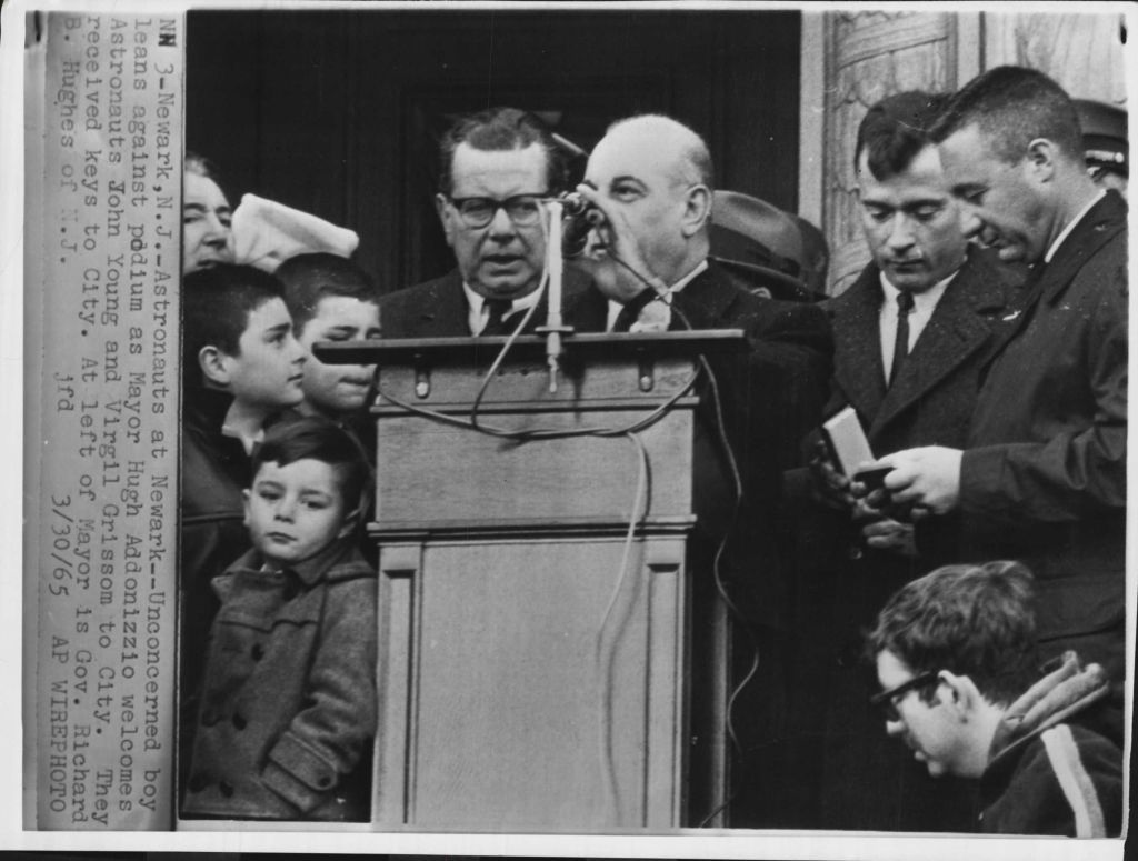 "lightthiscandle:  Newark, NJ: ""Unconcerned boy leans against podium as Mayor Hugh Addonizzio welcomes Astronauts John Young and Virgil Grissom to city. They received keys to city."" What's with that kid?"